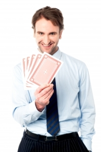 Businessman with playing cards